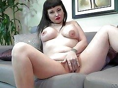 Carrie Ann is a raven haired tattooed milf nearby big